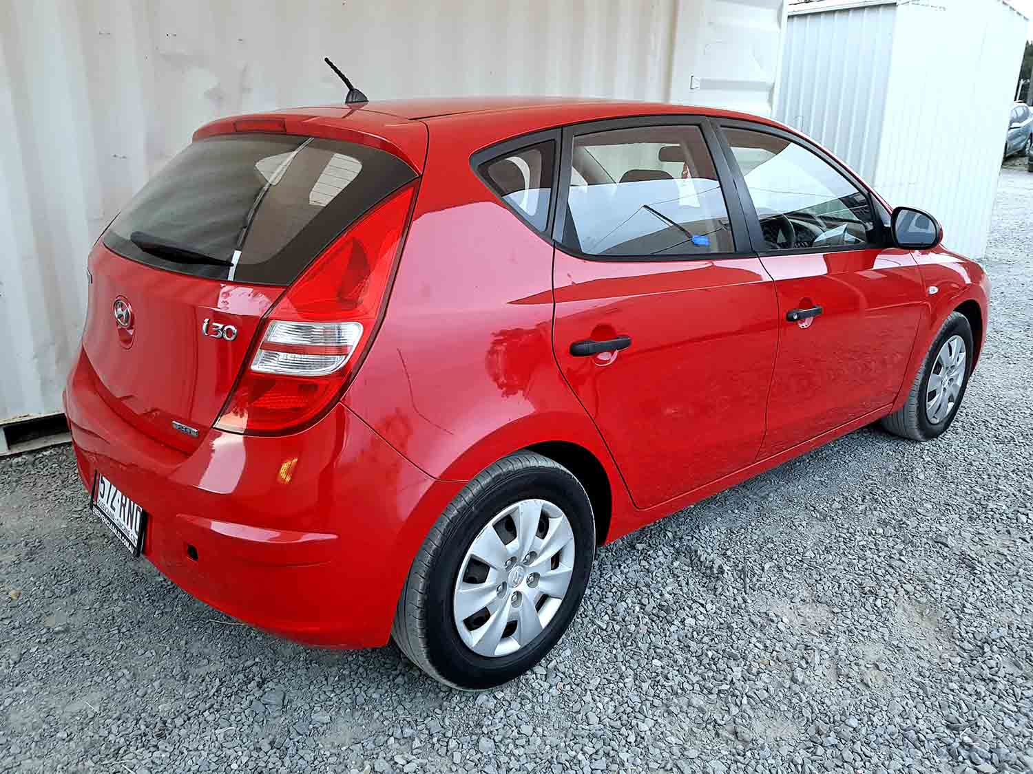 sold hatchback hyundai i30 2009 red used vehicle sales. Black Bedroom Furniture Sets. Home Design Ideas
